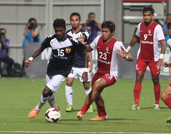 FLASHBACK: LionsXII's Zulfahmi Arifin (right) and Selangor's K. Gurusamy do battle at the Jalan Besar Stadium last month. The Singapore outfit are confident of bouncing back after losing to Pahang last week.