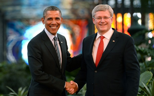US President Barack Obama shakes hands with Canadian Prime Minister Stephen Harper  Photo: JEWEL SAMAD/AFP/Getty
