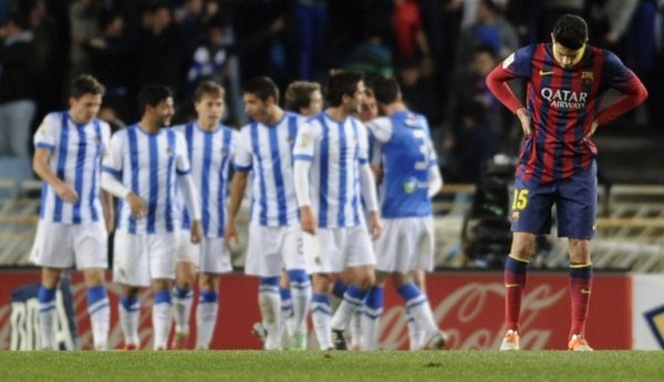 Barcelona's defender Marc Bartra stands after a Real Sociedad goal during the Spanish league football match Real Sociedad vs FC Barcelona at the Anoeta stadium in San Sebastian on February 22, 2014. AFP PHOTO / ANDER GILLENEA
