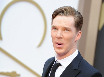 Actor Benedict Cumberbatch arrives on the red carpet for the 86th Academy Awards on March 2nd, 2014 in Hollywood, California. AFP PHOTO / Robyn BECK