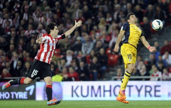 Athletic Bilbao's Andoni Iraola (left) with Atletico Madrid's Diego Costa. Atletico won 2-1. AFPpic