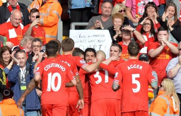 CAN'T GET ENOUGH: Liverpool's Luis Suarez (centre) celebrates scoring his team's second goal against Tottenham Hotspurs. Liverpool won 4-0 to go top of the English Premier League. AFPpic