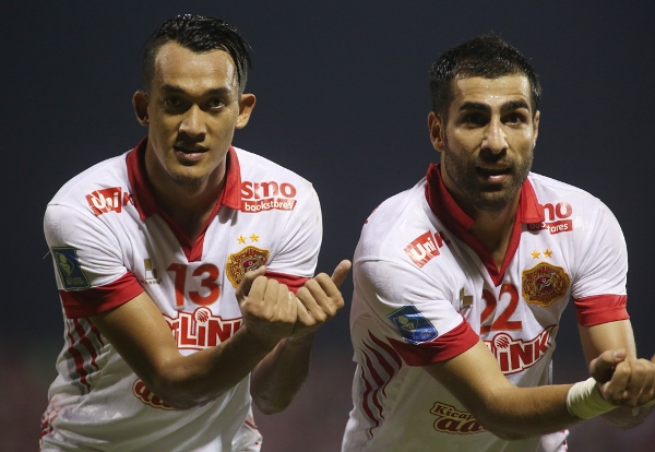 Fakri and Ghaddar celebrate the late equaliser which sent Kelantan into the semis 6-5 on aggregate.