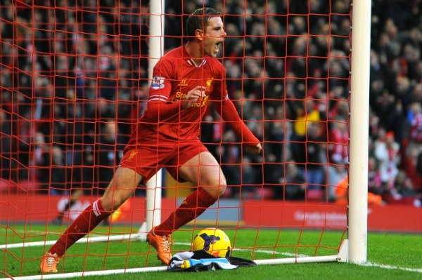 Liverpool's English midfielder Jordan Henderson celebrates scoring his team's fourth goal during the English Premier League football match between Liverpool and Swansea City at Anfield in Liverpool, northwest England on February 23, 2014. AFP PHOTO / ANDREW YATES RESTRICTED TO EDITORIAL USE. No use with unauthorized audio, video, data, fixture lists, club/league logos or ?live? services. Online in-match use limited to 45 images, no video emulation. No use in betting, games or single club/league/player publications.