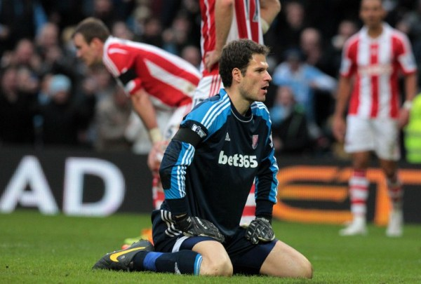 Stoke City's Bosnian goalkeeper Asmir Begovic reacts after conceding the only goal of the English Premier League football match between Manchester City and Stoke City at The Etihad Stadium in Manchester, northwest England on February 22, 2014. Manchester City won the game 1-0. AFP PHOTO / LINDSEY PARNABY RESTRICTED TO EDITORIAL USE. No use with unauthorized audio, video, data, fixture lists, club/league logos or ?live? services. Online in-match use limited to 45 images, no video emulation. No use in betting, games or single club/league/player publications.