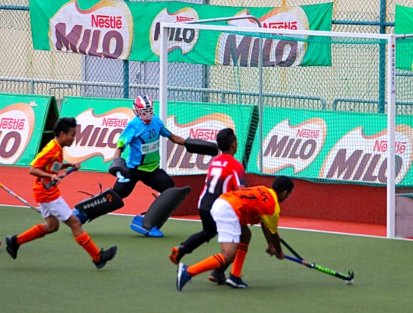 Olak-orange-and-Nur-Insafi-players-tussle-for-the-ball-in-a-goalmouth-action.