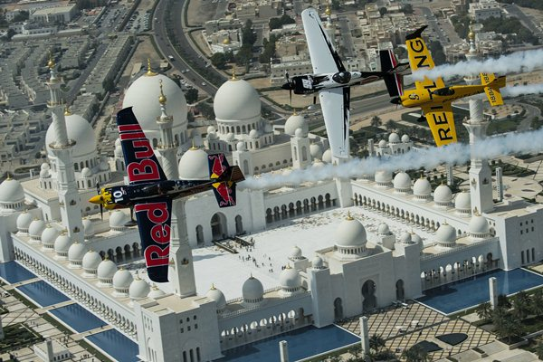 Kirby Chambliss and Michael Goulian of the United States and Nigel Lamb of Great Britain fly in formation over the Sheikh Zayed Mosque prior to the first stop of the Red Bull Air Race World Championship in Abu Dhabi, United Arab Emirates on February 26, 2014. // Jörg Mitter/Red Bull Content Pool // P-20140226-00543 // Usage for editorial use only // Please go to www.redbullcontentpool.com for further information. //