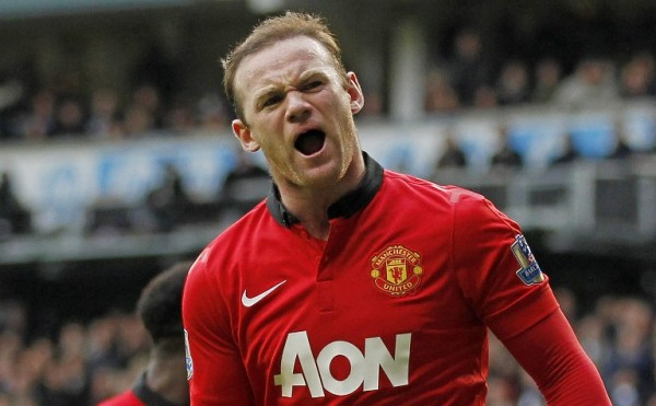 (Files) In this file picture taken on December 1, 2013, Manchester United's English striker Wayne Rooney celebrates scoring his second goal from the penalty spot during the English Premier League football match against Tottenham Hotspur at White Hart Lane in London. Wayne Rooney pledged his long-term future to Manchester United on on February 21 after signing a blockbuster contract extension with the Premier League champions. AFP PHOTO/IAN KINGTON RESTRICTED TO EDITORIAL USE. NO USE WITH UNAUTHORIZED AUDIO, VIDEO, DATA, FIXTURE LISTS, CLUB/LEAGUE LOGOS OR ?LIVE? SERVICES. ONLINE IN-MATCH USE LIMITED TO 45 IMAGES, NO VIDEO EMULATION. NO USE IN BETTING, GAMES OR SINGLE CLUB/LEAGUE/PLAYER PUBLICATIONS.