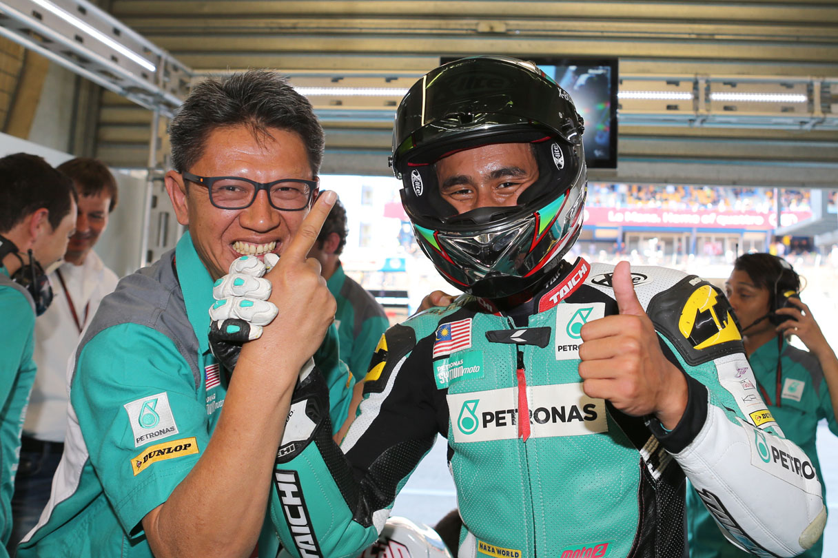 Hafizh celebrating his point with manager Barry Leong