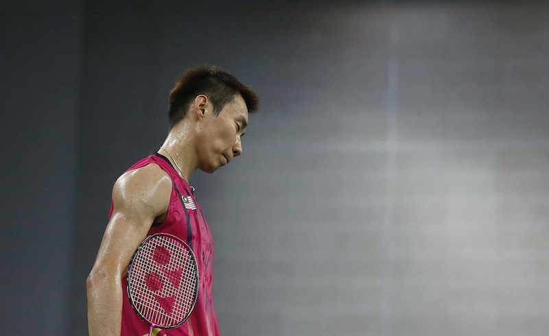 Malaysia's Lee Chong Wei reacts after losing a point against Vietnam during the men's singles quarter final badminton match at Gyeyang Gymnasium, at the 17th Asian Games in Incheon September 27, 2014.