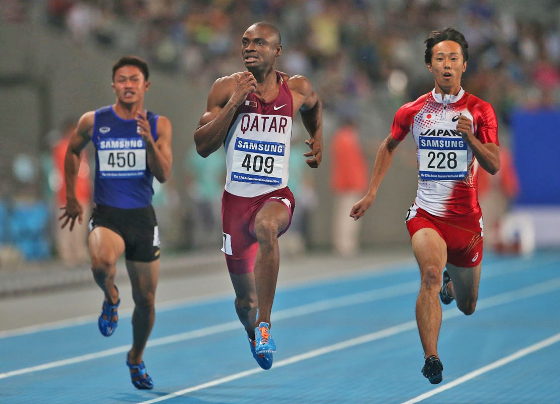 From left, Thailand's Ruttanapon Sowan, Qatar's Femi Ogunode and Japan's key Takase compete in the men's 100 meters semi final at the 17th Asian Games in Incheon, South Korea, Sunday, Sept. 28, 2014.