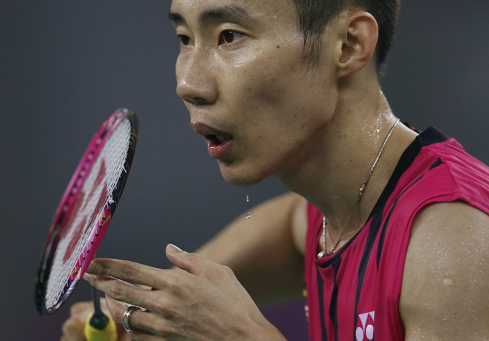 Malaysia's Datuk Lee Chong Wei sweats as he waits to return a serve against Nguyen Tien Minh during the men's singles quarter final badminton match at Gyeyang Gymnasium, at the 17th Asian Games in Incheon.