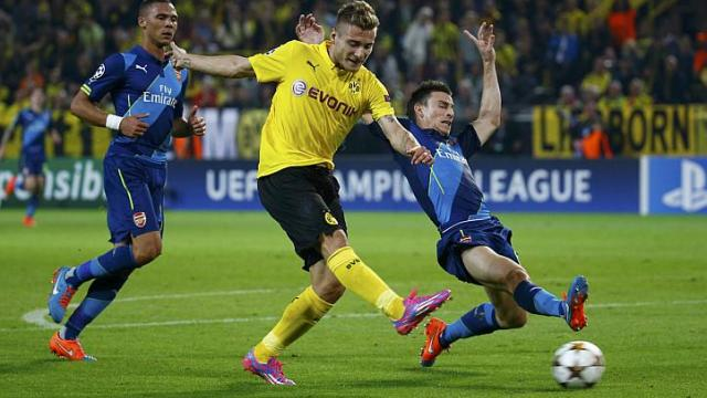 Borussia Dortmund's Ciro Immobile scores a goal past Arsenal's Laurent Koscielny (right) during their Champions League group D soccer match in Dortmund on Sept 16, 2014.