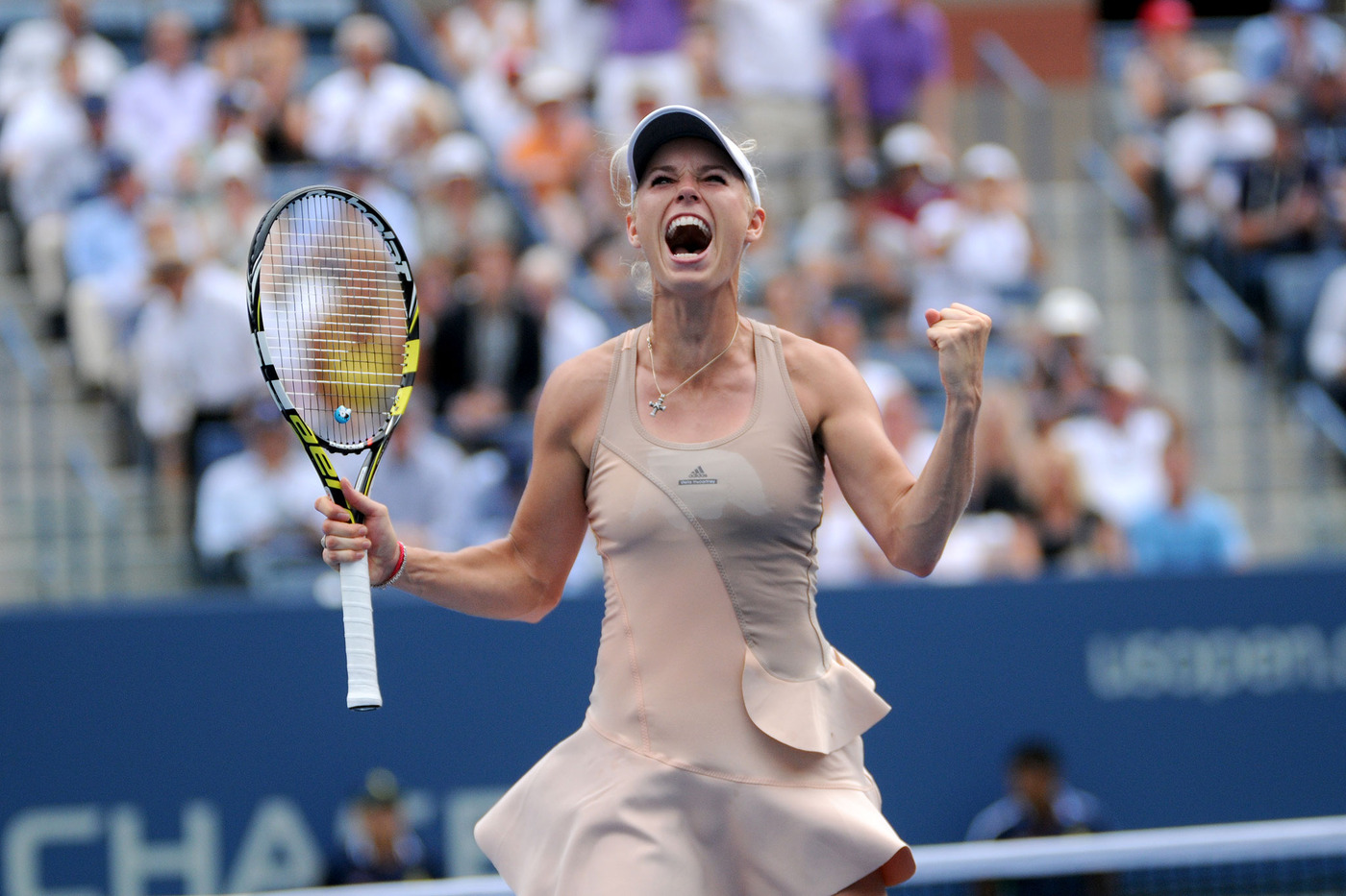 Tenth seed Caroline Wozniacki, the 2009 runner-up, defeats No. 5 Maria Sharapova in the fourth round 6-4, 2-6, 6-2. - Photo Credit: Mike Lawrence/usopen.org