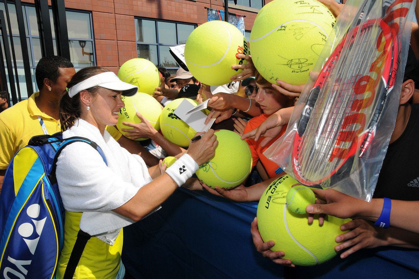 Martina Hingis signs autographs for fans at the 2014 US Open. - Photo Credit: Mike Lawrence/usopen.org