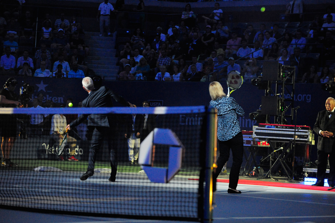 Martina Navratilova and John McEnore hit tennis balls into the stands during the Opening Ceremony on Arthur Ashe Stadium. - Photo Credit: Andrew Ong/usopen.org