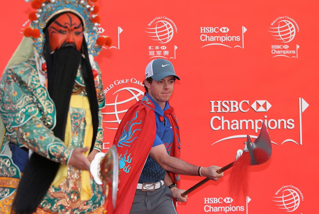 SHANGHAI, CHINA - OCTOBER 29: Rory McIlroy of Northern Ireland and a Chinese Warrior pose during a photocall prior to the start of the WGC-HSBC Champions at the Peninsula Hotel on October 29, 2013 in Shanghai, China. (Photo by Andrew Redington/Getty Images)