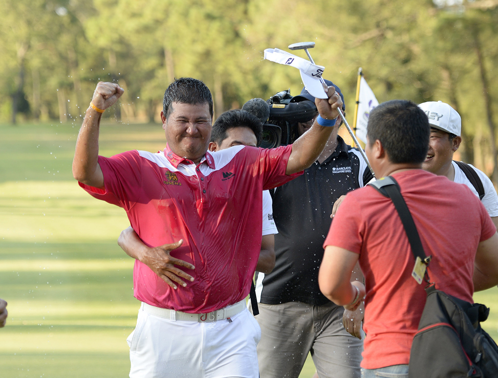 Prom Meesawat of Thailand pictured reacts and celebrates on the 18th green after winning in play-off against Miguel Tabuena of the Philippines on Sunday September 14, 2014 during the final round of the Yeangder Tournament Players Championship 2014.