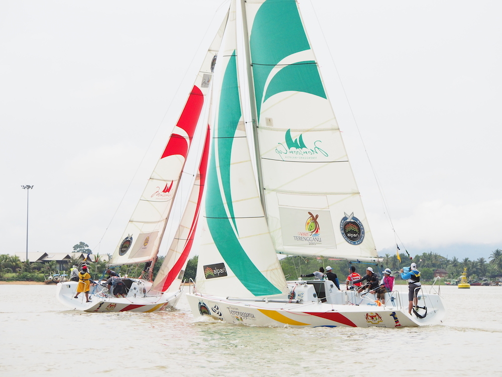 Jeremy Koo's Sime Darby Foundation/1Malaysia Match Racing Team (left) in action against Nurul Elia Anuar's ReMix Team during the final of LLM 2014 Pulau Duyong.
