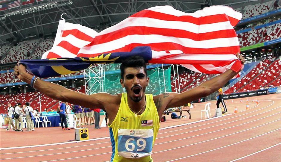 Aksi Nauraj Singh Randhawa setelah memenangi acara di Kejohanan Sukan SEA 2015 di Singapura. Kredit Photo - TheStar.com.my