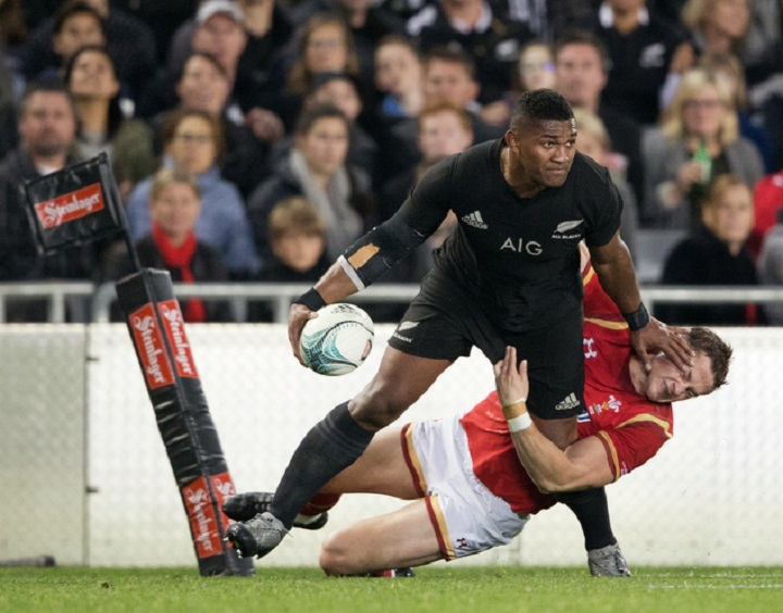 New Zealand All Black Waisake Naholo, left, fends off a Welsh defender during their rugby union test match in Auckland, New Zealand, Saturday, June 11, 2016. (Greg Bowker/New Zealand Herald via AP) NEW ZEALAND OUT, AUSTRALIA OUT