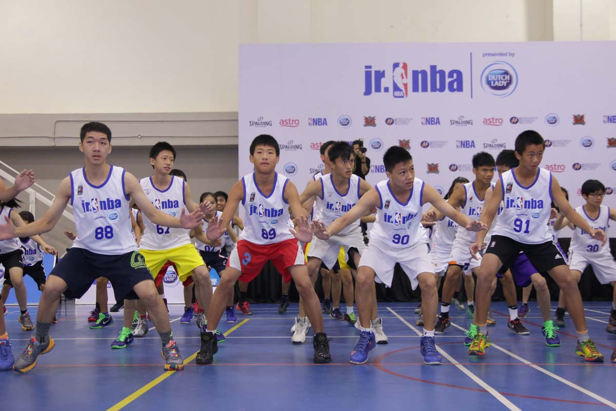 Participants going through the warmup session at the Jr. NBA Malaysia 2016 presented by Dutch Lady Regional Selection Camp.