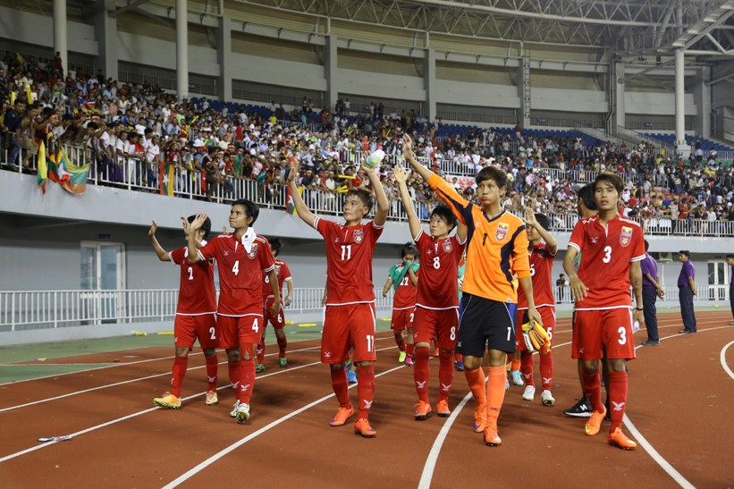 Myanmar players wave to fans
