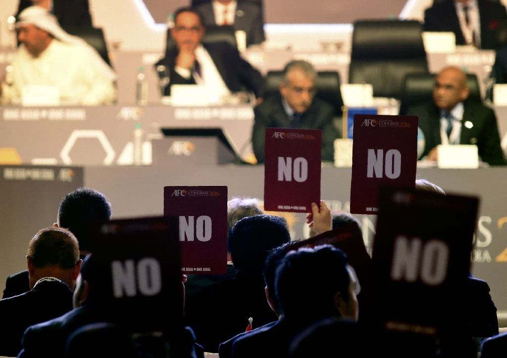 AFC members hold up 'NO' voting cards during the AFC Extraordinary Congress in Goa. AFP Photo.